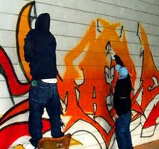 Two men painting graffitit